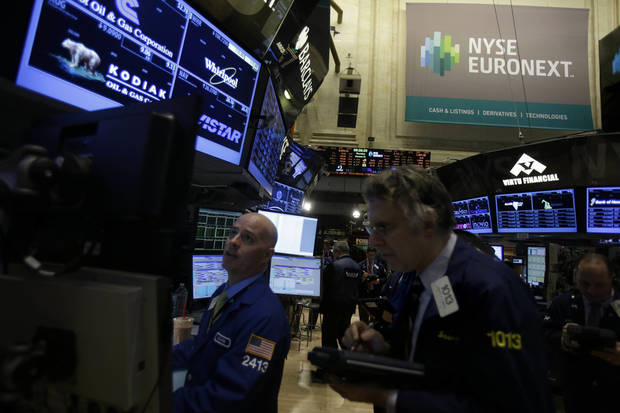 Traders work Thursday on the floor of the New York Stock Exchange. AP Photo