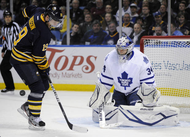 Buffalo Sabres center Cody Hodgson (19) gets hit with an incoming shot as he screens Toronto Maple Leafs goaltender James Reimer during the first period of an NHL hockey game in Buffalo, N.Y., Thursday, March 21, 2013. (AP Photo/Gary Wiepert)