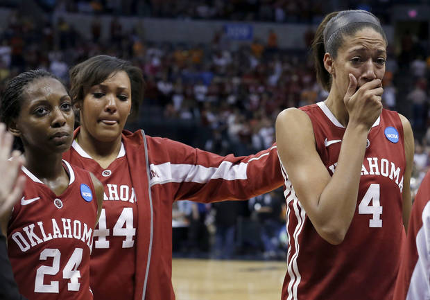 Oklahoma's Sharane Campbell (24), Lyndsey Cloman (44) and Nicole Griffin (4) react after losing to Tennessee at the  Oklahoma City Regional for the NCAA women's college basketball tournament at Chesapeake Energy Arena in Oklahoma City, Sunday, March 31, 2013. Photo by Sarah Phipps, The Oklahoman