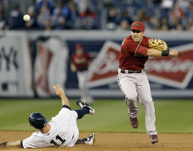 Arizona Diamondbacks shortstop Cliff Penning gets New York Yankees' Brett Gardner out at second after Vernon Wells hit into a first-inning double play in the Yankees' 4-3 winin a baseball game at Yankee Stadium in New York, Wednesday, April 17, 2013. (AP Photo/Kathy Willens)