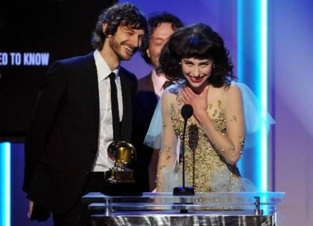"Gotye, left, and Kimbra accept the award for best pop duo/group performance for ""Somebody That I Used to Know"" during the pre-telecast at the 55th annual Grammy Awards on Sunday, Feb. 10, 2013, in Los Angeles. (AP)"