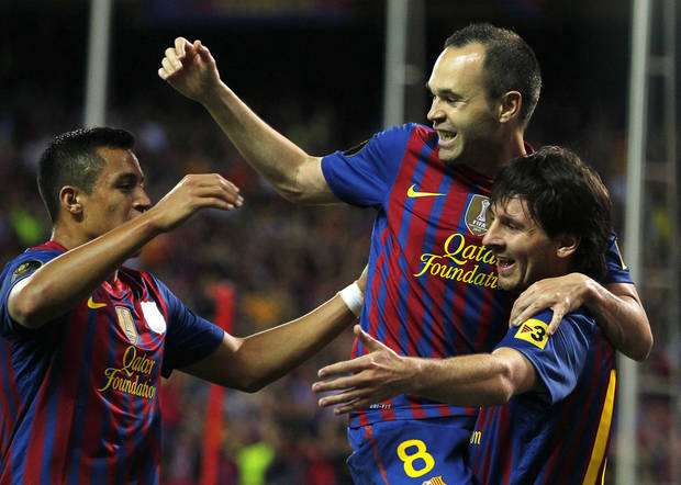 FC Barcelona's Lionel Messi from Argentina, right, celebrates his goal with Andres Iniesta, centre, and Alexis Sanchez from Chile, left, during the final Copa del Rey soccer match against Athletic Bilbao at the Vicente Calderon stadium in Madrid, Spain, Friday, May 25, 2012. (AP Photo/Andres Kudacki)