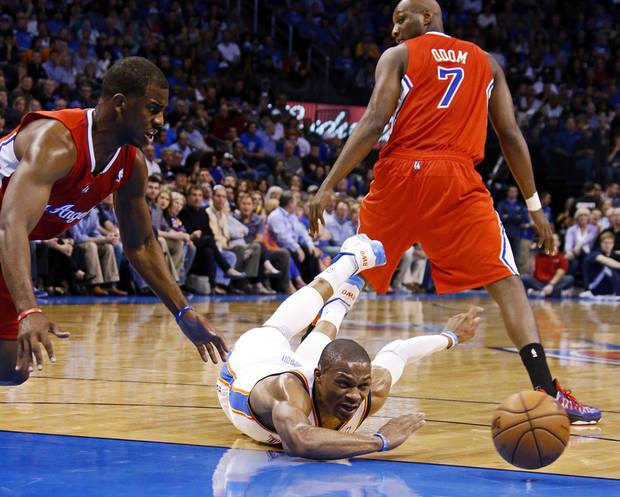 Oklahoma City&#039;s Russell Westbrook (0) dives for the ball beside the Clippers Chris Paul (3) during an NBA basketball game between the Oklahoma City Thunder and the Los Angeles Clippers at Chesapeake Energy Arena in Oklahoma City, Wednesday, Nov. 21, 2012. Photo by Bryan Terry, The Oklahoman