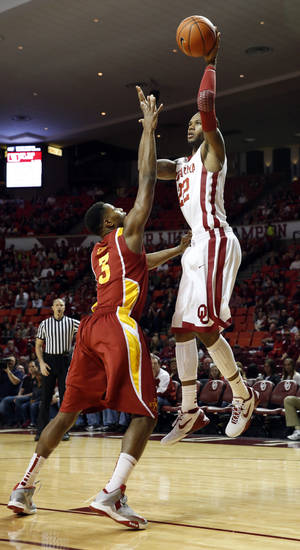 Oklahoma's Amath M'Baye (22) shoots guarded by Melvin Ejim (3) as the University of Oklahoma Sooners (OU) men play the Iowa State Cyclones in NCAA, college basketball at Lloyd Noble Center on Saturday, March 2, 2013  in Norman, Okla. Photo by Steve Sisney, The Oklahoman