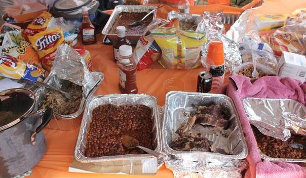 The spread at Javier and Greg&#039;s tailgate includes everything barbecue that you can imagine