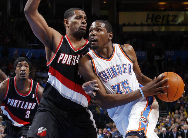 ALTERNATE CROP: Oklahoma City's Kevin Durant (35) drives to the basket as Kurt Thomas (40) defends for Portland in the first half during the NBA basketball game between the Oklahoma City Thunder and Portland Trail Blazers at Chesapeake Energy Arena in Oklahoma City, Tuesday, Jan. 3, 2012. At left is Gerald Wallace (3) of the Trail Blazers. Photo by Nate Billings, The Oklahoman