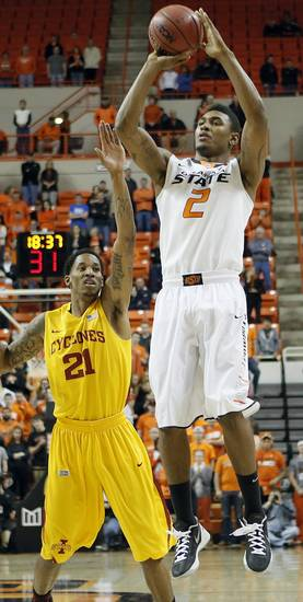 Oklahoma State Cowboys' Le'Bryan Nash (2) shoots over Iowa State Cyclones' Will Clyburn (21) during the college basketball game between the Oklahoma State University Cowboys (OSU) and the Iowa State University Cyclones (ISU) at Gallagher-Iba Arena on Wednesday, Jan. 30, 2013, in Stillwater, Okla.  Photo by Chris Landsberger, The Oklahoman