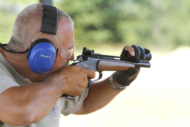 Minnesota shooter John Richards takes aim during the International Handgun Metallic Silhouette World Championships at the OKC Gun Club near Arcadia, OK, Friday, July 13, 2012. More than 600 shooters from four different countries are competing.  By Paul Hellstern, The Oklahoman