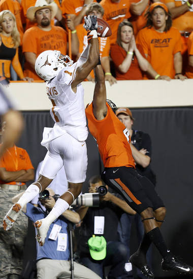 Texas' Mike Davis (1) makes a catch over Oklahoma State's Justin Gilbert (4) during a college football game between Oklahoma State University (OSU) and the University of Texas (UT) at Boone Pickens Stadium in Stillwater, Okla., Saturday, Sept. 29, 2012. Oklahoma State lost 41-36. Photo by Bryan Terry, The Oklahoman