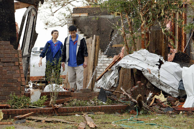 Residents walk through tornado damaged homes near SW 149th and Western on Monday, May 20, 2013  in Moore, Okla. Photo by Steve Sisney, The Oklahoman