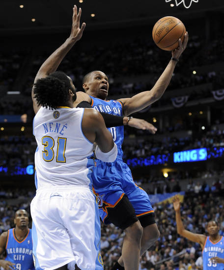 Oklahoma City Thunder guard Russell Westbrook (0) goes up for a shot against Denver Nuggets center Nene (31) from Brazil during the first half in game 4 of a first-round NBA basketball playoff series Monday, April 25, 2011, in Denver. (AP Photo/Jack Dempsey)