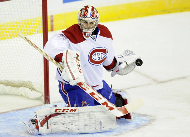 Montreal Canadiens goalie Carey Price (31) stops the puck during the first period of an NHL hockey game against the Washington Capitals, Thursday, Jan. 24, 2013, in Washington. (AP Photo/Nick Wass)