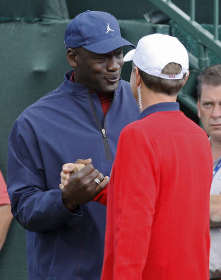 USA's captain Davis Love III, right, shakes hands with Michael Jordan before singles matches at the Ryder Cup PGA golf tournament Sunday, Sept. 30, 2012, at the Medinah Country Club in Medinah, Ill. (AP Photo/Charles Rex Arbogast)  ORG XMIT: PGA101