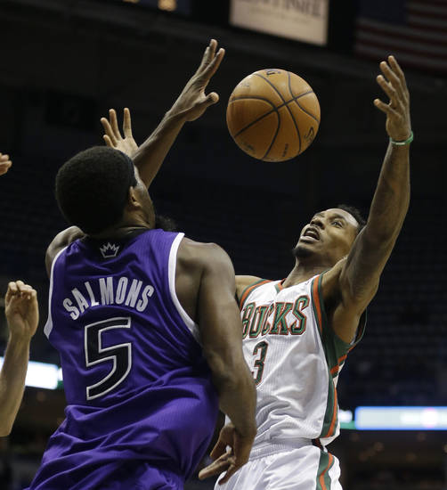 Milwaukee Bucks' Brandon Jennings, right, loses the ball against Sacramento Kings' John Salmons (5) during the second half of an NBA basketball game on Wednesday, Dec. 12, 2012, in Milwaukee. (AP Photo/Jeffrey Phelps)