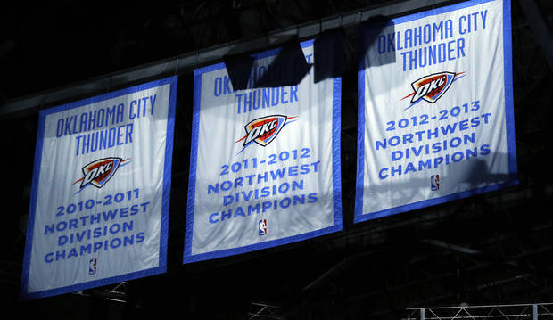 The Thunder unveil the 2012-2013 Northwest Division Champions banner during the season finally NBA basketball game between the Oklahoma City Thunder and the Milwaukee Bucks at Chesapeake Energy Arena on Wednesday, April 17, 2013, in Oklahoma City, Okla.   Photo by Chris Landsberger, The Oklahoman