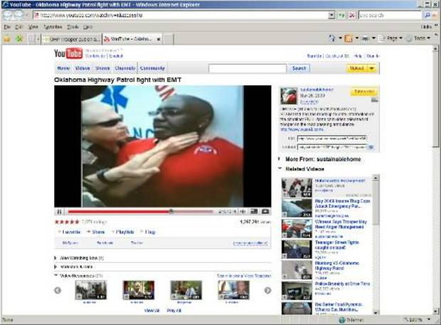 An image from a video showing the  scuffle posted on YouTube by the son of the patient inside the ambulance. OHP  Trooper Daniel Martin is seen on video tape placing his hands around the throat of a paramedic after Martin stopped the ambulance for failure to yield near Paden in May.