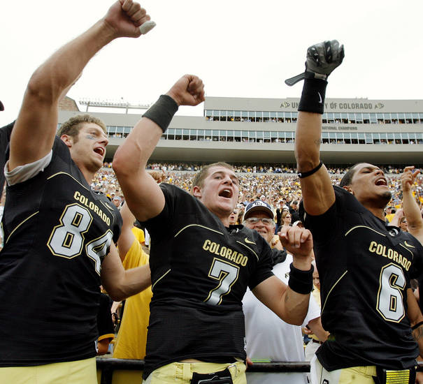 CU's Tyson DeVree (84), Cody Hawkins (7) and Gardner McKay (6) sing the University of Colorado's fight song after beating the University of Oklahoma Sooners (OU) at Folsom Field in Boulder, Co., on Saturday, Sept. 28, 2007. Colorado won, 27-24. By NATE BILLINGS, The Oklahoman