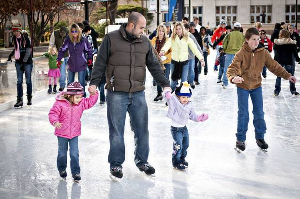 Ice skaters glide on the Devon Ice Rink at the Myriad Gardens in downtown Oklahoma City. The ice rink is the signature attraction of the Downtown in December festivities. Photo provided. <strong></strong>