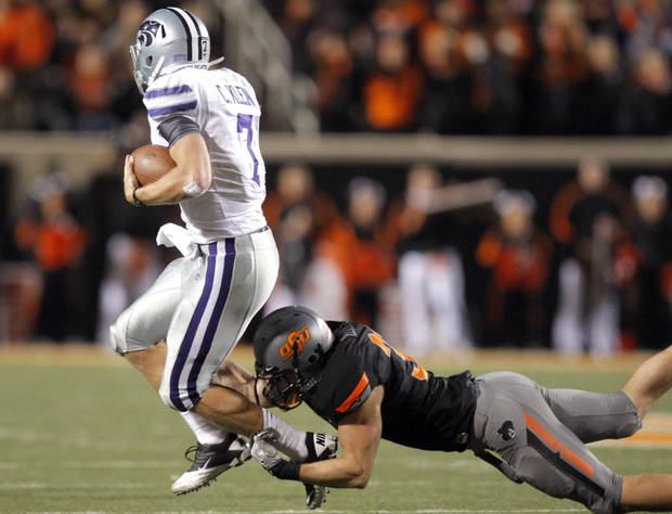 Oklahoma State's Alex Elkins (37) grabs Collin Klein (7) by the ankles during a college football game between the Oklahoma State University Cowboys (OSU) and the Kansas State University Wildcats (KSU) at Boone Pickens Stadium in Stillwater, Okla., Saturday, Nov. 5, 2011.  Photo by Sarah Phipps, The Oklahoman