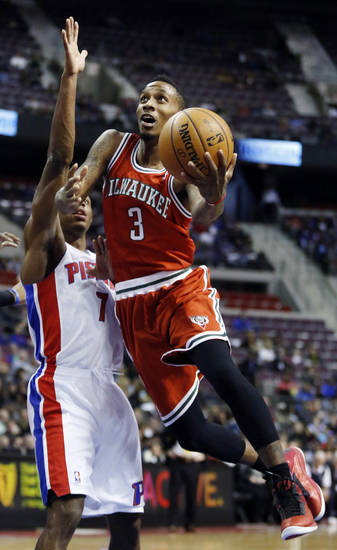Milwaukee Bucks guard Brandon Jennings (3) goes to the basket against Detroit Pistons guard Brandon Knight (7) in the first half of an NBA basketball game, Sunday, Dec. 30, 2012, in Auburn Hills, Mich. (AP Photo/Duane Burleson)