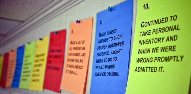 Rehabilitation signs are posted on the wall at Specialized Outpatient Services Wednesday.  Photo s by Chris Landsberger, The Oklahoman