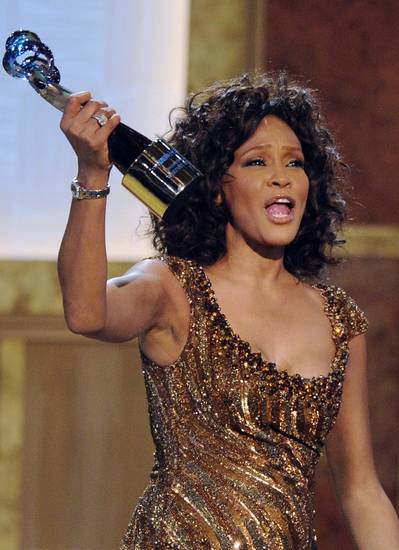 FILE - In this Saturday, Jan. 16, 2010 picture, Whitney Houston accepts an award at the Warner Theatre during the 2010 BET Hip Hop Honors in Washington. Houston was the �top trending� search of the year, according to Google Inc. People around the globe searched en masse for news about the superstar singer's sad, accidental drowning  (AP Photo/Nick Wass, file)