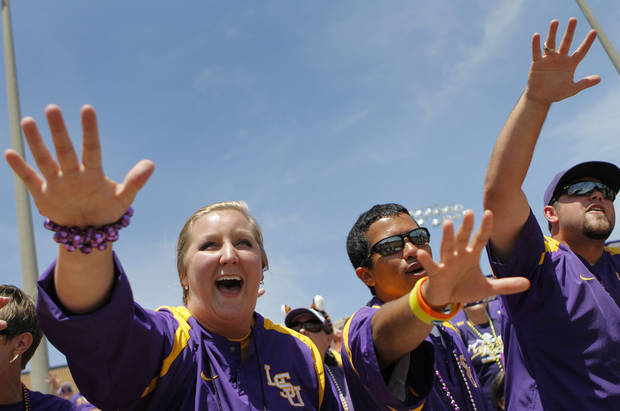 Caitlyn McKinley, Yuri Ashley, and Travis Clapp cheer for LSU during a Women's College World Series game between Louisiana State University and the University of South Florida at ASA Hall of Fame Stadium in Oklahoma City, Saturday, June 2, 2012.  Photo by Garett Fisbeck, The Oklahoman