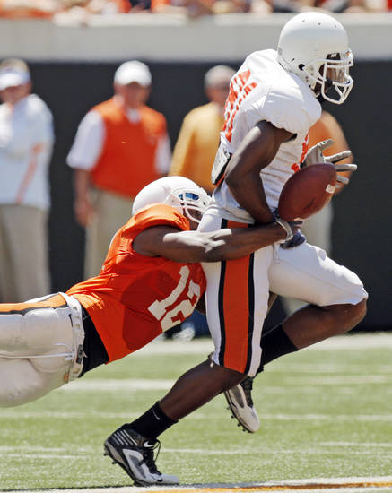 OSU's Johnny Thomas (12) strips the ball from Justin Blackmon (81) during the Orange/White spring football game for the Oklahoma State University Cowboys at Boone Pickens Stadium in Stillwater, Okla., Saturday, April 16, 2011. Photo by Nate Billings, The Oklahoman