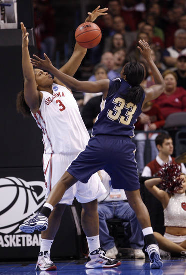 Courtney Paris blocks a shot by Xenia Stewart in the first half of the NCAA women's basketball tournament game between the University of Oklahoma and Pittsburgh at the Ford Center in Oklahoma City, Okla. on Sunday, March 29, 2009. 