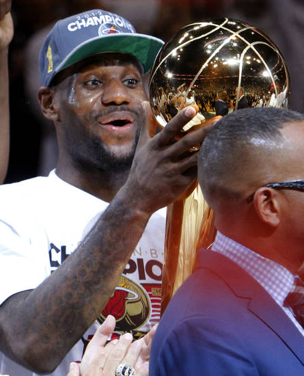 Miami's LeBron James holds the Larry O'Brien NBA Championship Trophy during Game 5 of the NBA Finals between the Oklahoma City Thunder and the Miami Heat at American Airlines Arena, Thursday, June 21, 2012. Oklahoma City lost 121-106. Photo by Bryan Terry, The Oklahoman