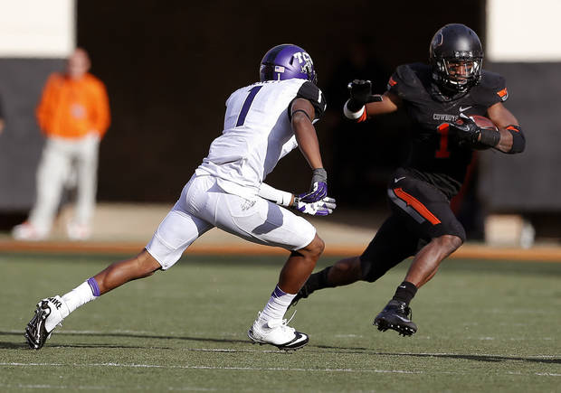 Oklahoma State's Joseph Randle (1) tries to get by .TCU's Chris Hackett (1) during a college football game between Oklahoma State University (OSU) and Texas Christian University (TCU) at Boone Pickens Stadium in Stillwater, Okla., Saturday, Oct. 27, 2012. Photo by Sarah Phipps, The Oklahoman