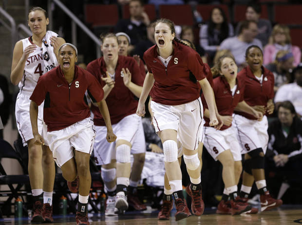 Stanford players rush off the bench to greet teammates during a timeout against Colorado late in the second half of an NCAA college basketball game in the Pac-12 Conference tournament Saturday, March 9, 2013, in Seattle. Stanford won 61-47. (AP Photo/Elaine Thompson)