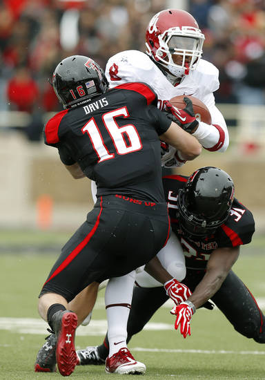 Oklahoma's Dominique Whaley (8) tries to get past Texas Tech's Cody Davis (16) and Eugene Neboh (31) during a college football game between the University of Oklahoma (OU) and Texas Tech University at Jones AT&T Stadium in Lubbock, Texas, Saturday, Oct. 6, 2012. Oklahoma won 41-20. Photo by Bryan Terry, The Oklahoman