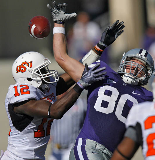 Oklahoma State's Johnny Thomas 912) breaks up a pass for Kansas State's Travis Tannahill (80) during the second half of the college football game between the Oklahoma State University Cowboys (OSU) and the Kansas State University Wildcats (KSU) on Saturday, Oct. 30, 2010, in Manhattan, Kan.   Photo by Chris Landsberger, The Oklahoman