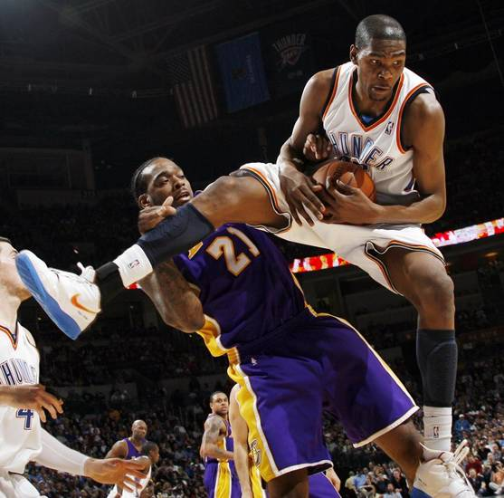 L.A. LAKERS: Kevin Durant (35) of Oklahoma City tries for a rebound as he is fouled by Josh Powell (21) of Los Angeles during the NBA basketball game between the Los Angeles Lakers and the Oklahoma City Thunder at the Ford Center in Oklahoma City, Friday, March 26, 2010. Oklahoma City won, 91-75. Photo by Nate Billings, The Oklahoman ORG XMIT: KOD