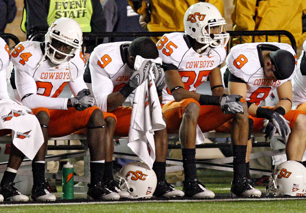 Members of the Oklahoma State offense sit on the bench during the 56-20 loss in the college football game between the Oklahoma State University Cowboys (OSU) and the Texas Tech Red Raiders at Jones AT&T Stadium on Saturday, Nov. 8, 2008, in Lubbock, Tex.