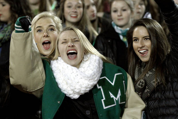 McGuinness fans Grace Amundsen, Jorden Stephens and Hayden TYerlip cheer as the Bishop McGuinness Irish play the Carl Albert Titans in a Class 5A semi-final playoff game at Harve Collins Field on Friday, Nov. 23, 2012  in Norman, Okla. Photo by Steve Sisney, The Oklahoman