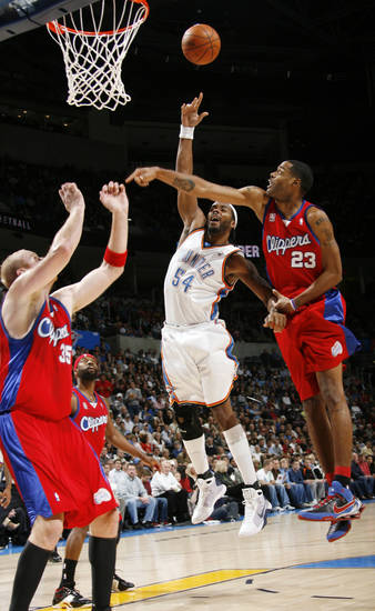 Chris Wilcox of the Thunder shoots past, from left, Chris Kaman, Baron Davis and Marcus Camby of the Clippers in the first half of the NBA basketball game between the Oklahoma City Thunder and the Los Angeles Clippers at the Ford Center in Oklahoma City, Wednesday, Nov. 19, 2008. BY NATE BILLINGS, THE OKLAHOMAN