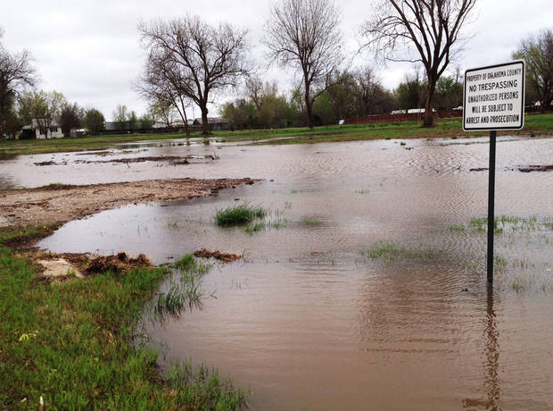 Roadside flooding in a field south of NE 23 on Boyd Street in Midwest City in Crutcho Creek area. Photo by Jim Beckel