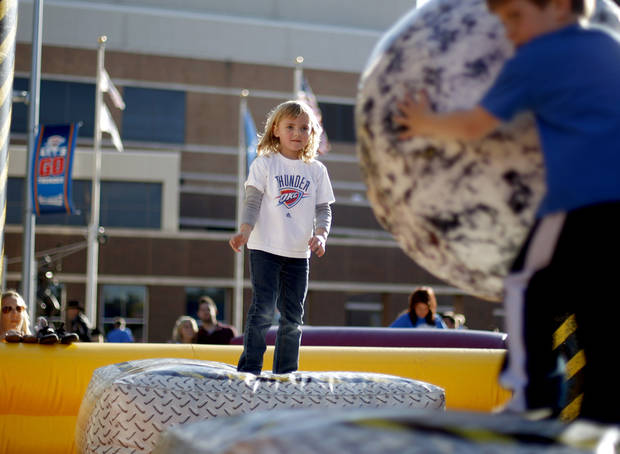 Jenna Metzger, 5, of Edmond plays on an inflatable structure outside the Oklahoma City Arena before game two of the Western Conference semifinals between the Memphis Grizzlies and the Oklahoma City Thunder in the NBA basketball playoffs at Oklahoma City Arena in Oklahoma City, Tuesday, May 3, 2011. Photo by Bryan Terry, The Oklahoman