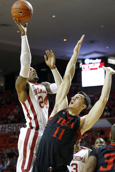 Oklahoma's Romero Osby (24) puts up a shot beside Texas Tech's Dejan Kravic (11) during an NCAA college basketball game between the University of Oklahoma and Texas Tech University at Lloyd Noble Center in Norman, Okla., Wednesday, Jan. 16, 2013. Photo by Bryan Terry, The Oklahoman