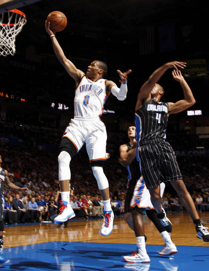 Oklahoma City's Russell Westbrook (0) takes the ball to the hoop past Orlando's Arron Afflalo (4) during an NBA basketball game between the Oklahoma City Thunder and the Orlando Magic at Chesapeake Energy Arena in Oklahoma City, Friday, March 15, 2013. Photo by Nate Billings, The Oklahoman
