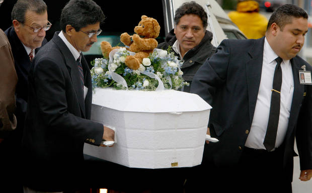 FILE - In this Jan. 23, 2009 file photo, pallbearers carry the casket of 4-year-old Roberto Lopez Jr., outside Our Lady of Angels Church in Los Angeles. The boy was shot in the chest a week earlier as he walked with his 5-year-old sister in a gang-plagued Echo Park neighborhood. In the wake of the Dec. 14, 2012 mass shooting at Sandy Hook Elementary School in the small town of Newtown, Conn., there is now much political discussion about gun control. For urban advocates, this new emphasis on gun control is long overdue. (AP Photo/Mark Boster, Pool, File)