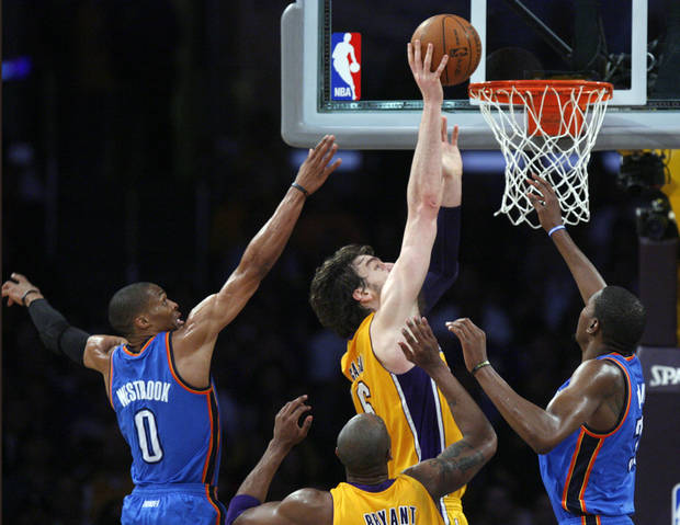Los Angeles' Pau Gasol (16) shoots a basket as Oklahoma City's Russell Westbrook (0) and Kevin Durant (35) defend during Game 4 in the second round of the NBA basketball playoffs between the L.A. Lakers and the Oklahoma City Thunder at the Staples Center in Los Angeles, Saturday, May 19, 2012. Photo by Nate Billings, The Oklahoman
