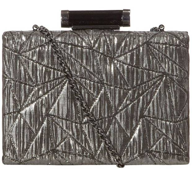 "While striking pose after pose at events to promote the newly released ""Les Miserables,"" Anne Hathaway has captivated her fans in designs that are edgy, fashion forward and refreshingly different. For a similar look try this silver shimmer box clutch ($27 from DorothyPerkins.com). (Los Angeles Times/MCT)"