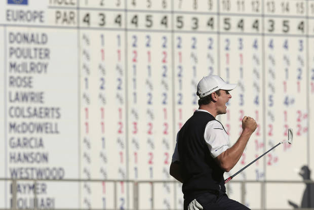 Europe's Justin Rose reacts after defeating USA's Phil Mickelson on the 18th hole during a singles match at the Ryder Cup PGA golf tournament Sunday, Sept. 30, 2012, at the Medinah Country Club in Medinah, Ill. (AP Photo/Charlie Riedel)  ORG XMIT: PGA166