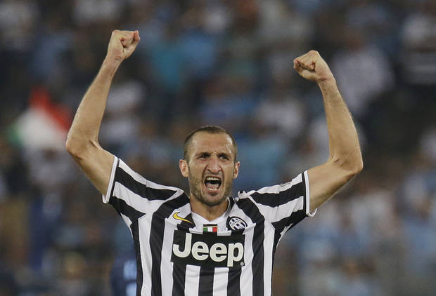 Juventus defender Giorgio Chiellini celebrates after scoring during the Italian Supercup soccer match against Lazio at the Rome Olympic stadium Sunday, Aug. 18, 2013. (AP Photo/Gregorio Borgia)