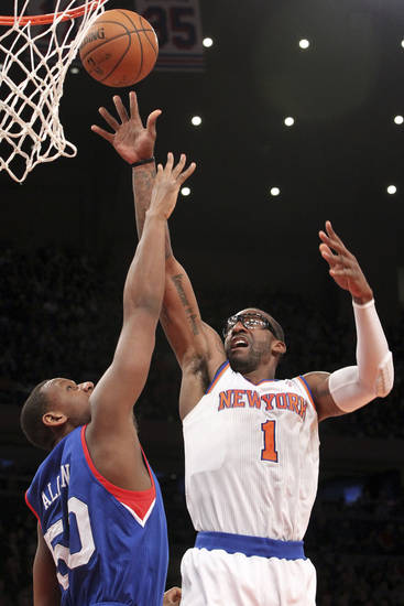New York Knicks' Amare Stoudemire (1) shoots against Philadelphia 76ers' Lavoy Allen during the first half of an NBA basketball game, Sunday, Feb. 24, 2013, at Madison Square Garden in New York. (AP Photo/Mary Altaffer)