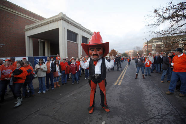 Pistol Pete warms up the crowd before the Bedlam college football game between the Oklahoma State University Cowboys (OSU) and the University of Oklahoma Sooners (OU) at Boone Pickens Stadium in Stillwater, Okla., Saturday, Dec. 3, 2011. Photo by Sarah Phipps, The Oklahoman