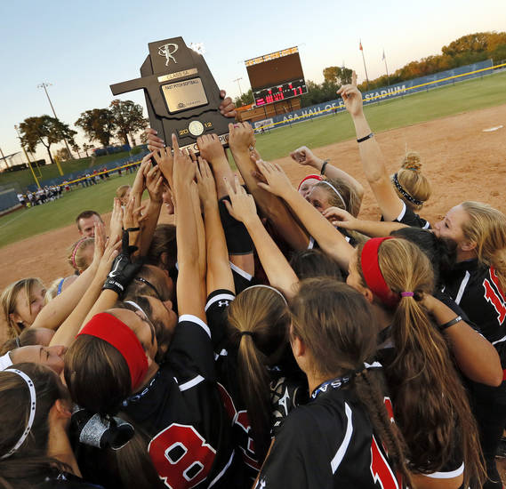 Grove celebrates with the championship trophy after winning the 5A state championship fast-pitch softball game against Chickasha at ASA Hall of Fame Stadium in Oklahoma City, Monday, Oct. 15, 2012. Grove won, 3-2. Photo by Nate Billings, The Oklahoman